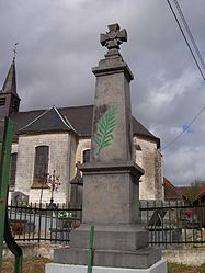 The monument to the dead in front of the church of Guisy