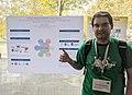 Gustavo Candela junto al póster que presentaron en WikidataCon 2019.jpg