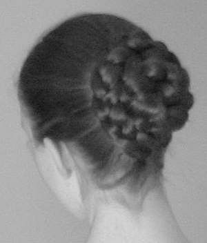 Picture of the back of a woman's head, with he...