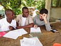 Haitian students learn English from Canadian volunteer.jpg