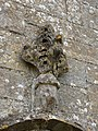Harlaxton Ss Mary and Peter - exterior North Aisle door finial.jpg