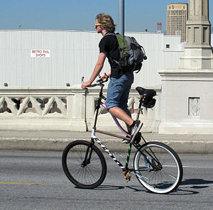 English: Young man riding a modified bicycle, ...