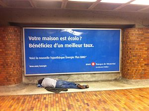 English: Homeless person sleeping in front of ...