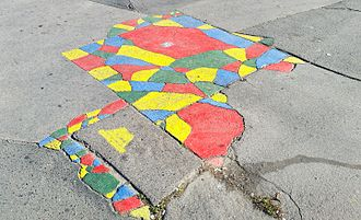 Hungarian Two-tailed Dog Party - Street art illustrating the four color theorem in Budapest