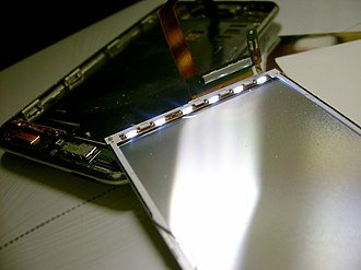 LED-backlit LCD - An Apple iPod Touch disassembled to show the array of white-edge LEDs powered on with the device