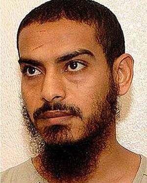 Mustafa al-Shamyri - Mustafa Abdul Oowi Abdul al-Shamiri's Guantanamo identity portrait, showing him wearing the white uniform issued to compliant individuals.