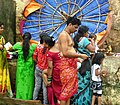 Indian family preparing for a bath in the Ganges.jpg
