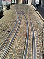 Interlaced tram tracks in Alfama, Lisbon.jpg