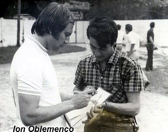 Ion Oblemenco - Oblemenco signing an autograph for a fan.