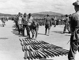 Guntō - Japanese officers surrender their swords to Indian troops in Malaya, after the surrender of Japan, 1945