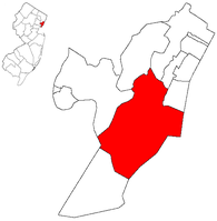Location of Jersey City within Hudson County. Inset: Location of Hudson County highlighted within the state of New Jersey.