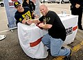 John Cena, left, arm-wrestles with a fan at the Navy Exchange Norfolk.jpg