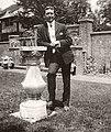 John McCrae leaning against a sundial.jpg
