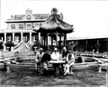 Johnston, Puyi and Wanrong in the Zhang Garden in Tianjin, 1920s.png