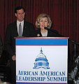 Kay Bailey Hutchison and Rick Santorum address the 2004 African American Leadership Summit in Washington.jpg