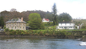 Northland Region - Kerikeri, Bay of Islands. Stone Store at left, St James at rear, and the Mission House on the right, the country's oldest surviving building.