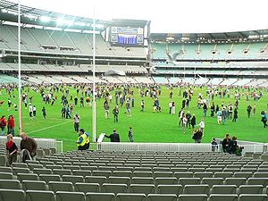 Variations of Australian rules football - The after game kick-to-kick tradition at the Melbourne Cricket Ground is a rare sight. Following an AFL match between the Melbourne Demons and Port Adelaide Power, 16,000 fans were let onto the hallowed turf.