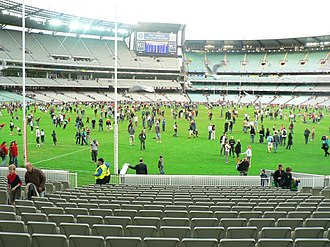 Pitch invasion - After-game kick-to-kick tradition at the Melbourne Cricket Ground is a rare sight. This follows an AFL match between the Melbourne Demons and Port Adelaide Power; 16000 fans were let onto the turf.