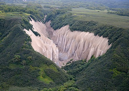 Kutkhiny Baty, a pumice rock formation outcrop located 4 km from the source of the Ozernaya River (Lake Kurile), near the southern tip of the Kamchatka Peninsula, Russia. Kuthiny Baty.jpg