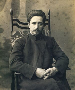 English: Leonid Andreyev sitting on a chair II