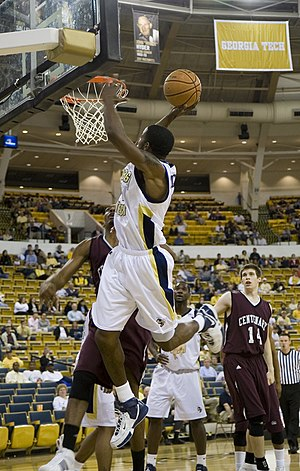 A slam dunk in a college basketball game between the Georgia Tech Yellow Jackets and the Centenary Gentlemen.