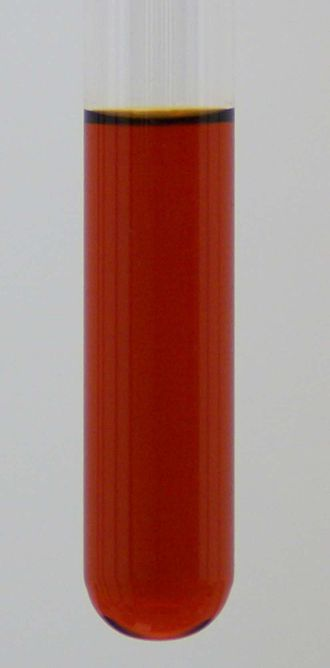 Lycopene - Test tube containing a dichloromethane solution of lycopene