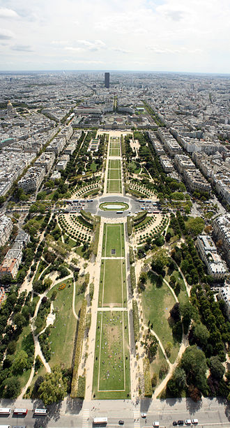 Champ de Mars - View southeast from the top level of the Eiffel Tower, down the Champ de Mars, with the Tour Montparnasse (Montparnasse Tower) in the distance. The Ecole Militaire is one third down from the top of the picture.