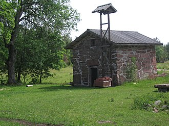 An old storehouse with a bell in the village of Ragetsbole in Finstrom, Aland Magasin.JPG