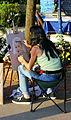 Malinska Hafenpromenade Strassenmalerin Portrait.JPG