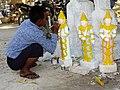 Man Painting Buddha Sculptures - Mandalay - Myanmar (Burma) (11996242573).jpg