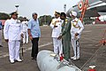 Manohar Parrikar being briefed by Capt. Theophilis, Commanding Officer INAS 303 about Mig 29K fighter aircraft, during his visit to the Naval Air Station INS Hansa, at Goa on November 14, 2014.jpg