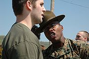 Marine Corps drill instructor yells at recruit