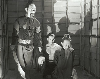 Mark Dacascos - Dacascos (center) in a deleted scene from Dim Sum