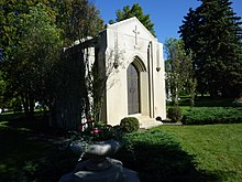 "White stone mausoleum with iron doors and ""Mars"" engraved near the top"