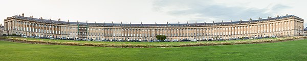 Panoramic view of the Royal Crescent, a crescent-formed row of 30 terraced houses in Bath, England. The building, one of the the greatest examples of Georgian architecture in the United Kingdom, was designed by John Wood the Younger and built between 1767 and 1774.