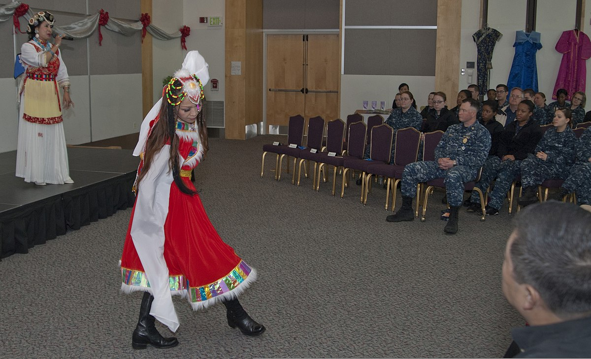 Members of Shen Yun, a classical Chinese dance company, perform a traditional Chinese song and dance for U.S. Sailors during an Asian-American and Pacific Islander Heritage Month celebration in the Grand Vista 130529-N-MM360-055.jpg