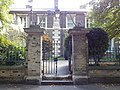 Mercers Cottages, Stepney - gate piers and overthrow 02.jpg