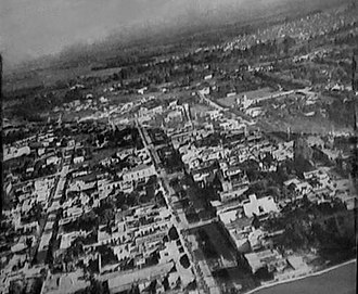 Merlo Partido - Aerial sight of Avenida Ituzaingó (present days Avenida del Libertador San Martín), Merlo city's main street, around 1950. In upper-right corner, Parque San Martín.