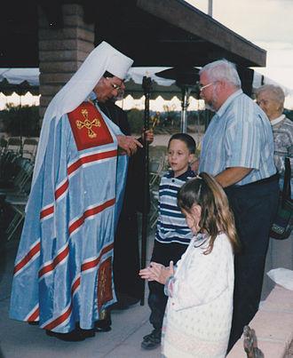 Klobuk - An Eastern Catholic Metropolitan wearing a white klobuk.