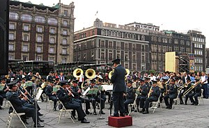 Old Portal de Mercaderes (Mexico City) - Mexican military band playing on Zocalo in front of the commercial buildings of the west side.