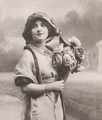 Miss Daisy Burrell portrait with roses.png