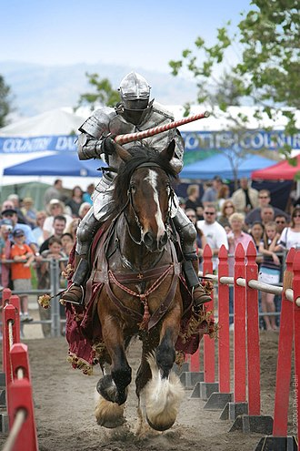 Combat reenactment - A contemporary knight jousting at a Renaissance Fair in Livermore California, 2006.