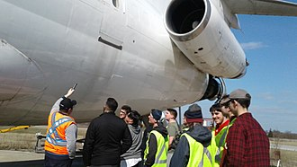 Aircraft maintenance engineer (Canada) - Students of aviation maintenance program evaluating a B727-200 with instructor.