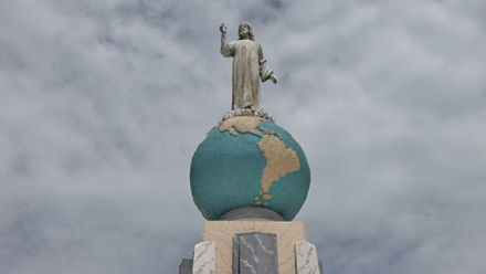 The iconic statue of Christ on the globe sphere of planet earth is part of the Monumento al Divino Salvador del Mundo (Monument to the Divine Savior of the world) on Plaza El Salvador del Mundo (The Savior of the World Plaza), a landmark located in the country's capital, San Salvador. Monumento al Salvador del Mundo 2.jpg