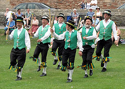 Morris dancing in the grounds of Wells Cathedral, Wells, England - Exeter Morris Men