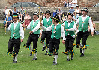 Morris dance - Cotswold-style Morris dancing in the grounds of Wells Cathedral, Wells, England – Exeter Morris Men