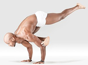 Yoga as exercise - A hand-standing yoga pose