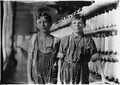 Mule spinning room in Chace Cotton Mill. Left hand - Leopold Daigneau, Arsene Lussier, Back roping boys. Burlington, Vt. - NARA - 523190.tif