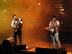 Mumford & Sons - Marcus Mumford and Winston Marshall on stage in Brighton, 4 October 2010