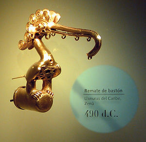 Zenú - A lowland Zenú cast-gold bird ornament that served as a staff head, dated 490 CE. This culture used alloys with a high gold content. The crest of the bird consists of the typical Zenú semi-filigree. Regular filigree is braided wire, but the Zenú cast theirs.